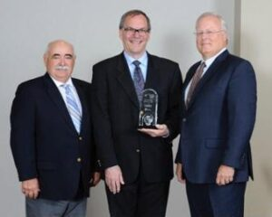 Pictured from left, CDI Chairman John Azevedo, Dairy Foods Magazine Editor-in-Chief Jim Carper, and CDI President and Chief Executive Officer Andrei Mikhalevsky