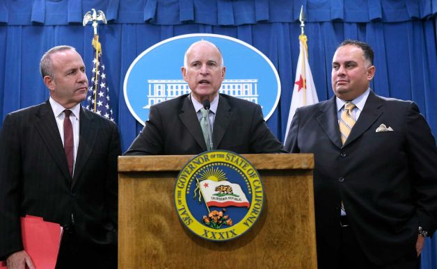 From left to right: President pro Tem, Darrell Steinberg (D-Sacramento), Governor Jerry Brown and Speaker John Perez (D-LA) - photo by Rich Pedroncelli, courtesy of the SF Chronicle.