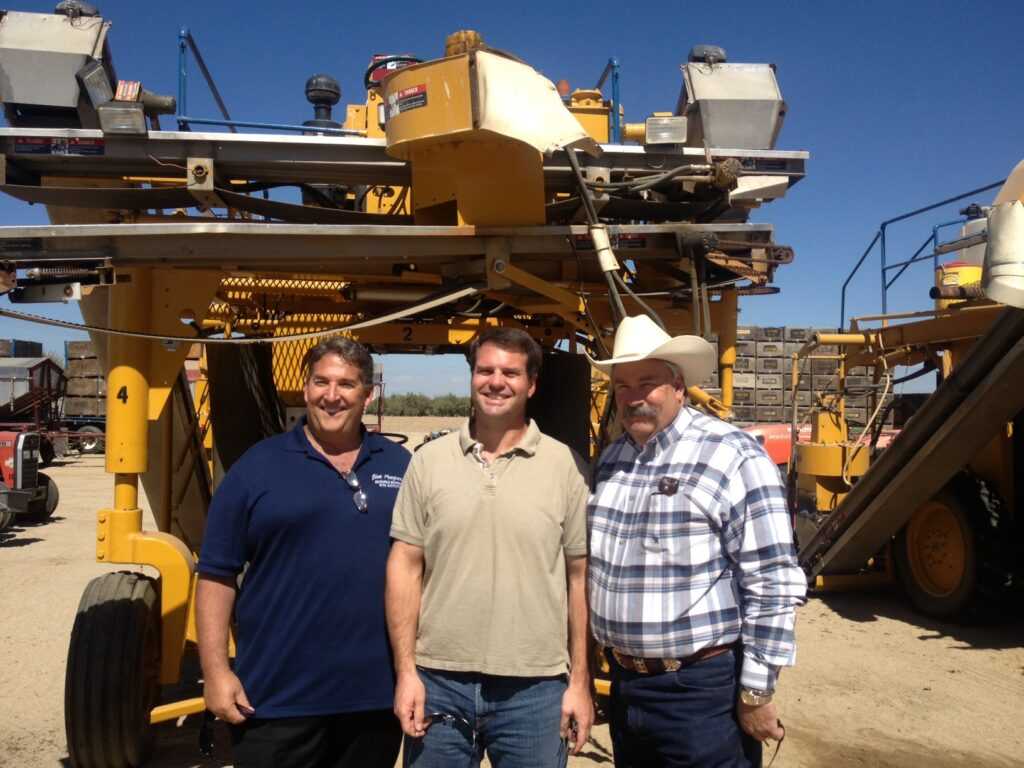 From L-R: Assemblyman Frazier, Mathew Andrew & Assemblyman Bigelow in front of harvesting equipment.