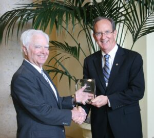Gray Allen (l) receives the Cultivator Award from Ag Council Chair Rich Hudgins (r).