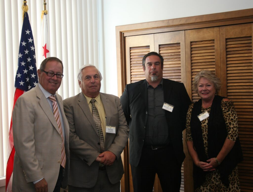 Senator Tom Berryhill (pictured on the left) meets with (from left to right) George Goshgarian, George Goshgarian Jr. and Susan Brauner—all three representing Blue Diamond Growers.