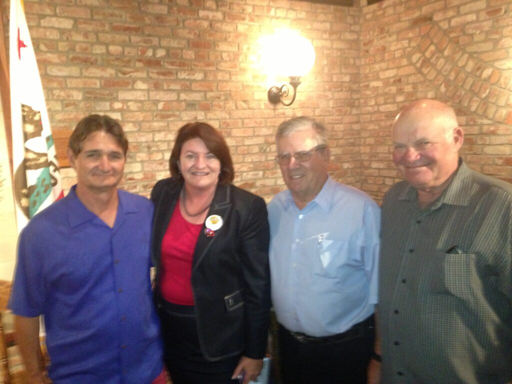 Assembly Speaker Toni Atkins (shown 2nd from left), with dairymen (from L-R) Ben Curti, Case van Steyn and George Mertens.