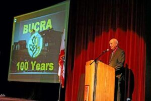 Photo courtesy Butte County Rice Growers Association Association Homer Lundberg gives an invocation at the celebration for Butte County Rice Growers' 100th year as a rice cooperative.