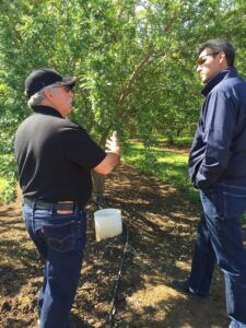 Dan Clendenin, a farmer with Blue Diamond Growers, speaks with Assembly Ag Committee Chairman Henry Perea (D-Fresno) about water use efficiencies.