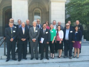 A grouop of Legislative Day attendees in front of the State Capitol