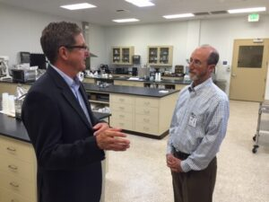 From L-R: Blue Diamond's Director of Research and Development Steve Morgan speaks with Senator Steve Glazer (D-Orinda) during a tour of the Almond Innovation Center.